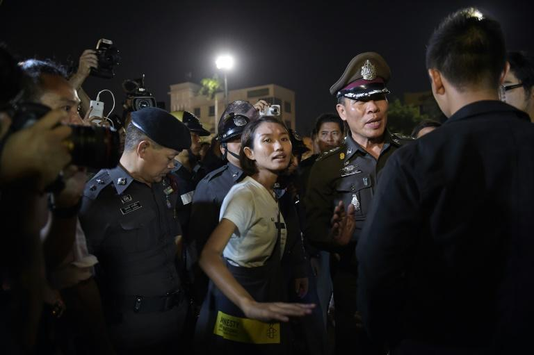 A student (C) is surrounded by police during a rally at Democracy Monument in Bangkok, in September 2015, when around 200 pro-democracy protesters rallied peacefully in defiance of the ruling junta's ban on political gatherings
