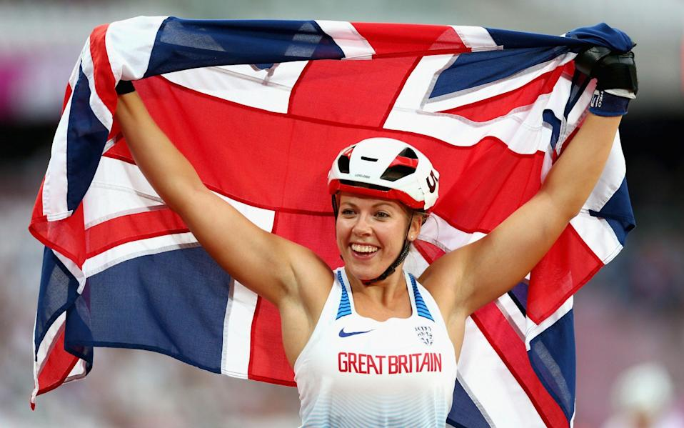 Hannah Cockroft of Great Britain celebrates winning gold in the Women's 800m T34 Final - GETTY IMAGES
