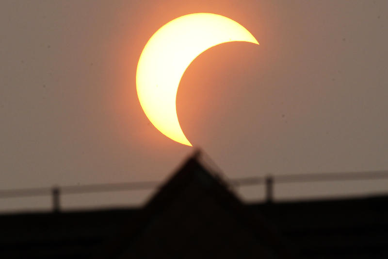 A partial annular eclipse appears over Beijing, China, Monday, May 21, 2012. The annular eclipse, in which the moon passes in front of the sun leaving only a golden ring around its edges, was visible to wide areas across China, Japan and elsewhere in the region before moving across the Pacific to be seen in parts of the western United States. (AP Photo/Ng Han Guan)