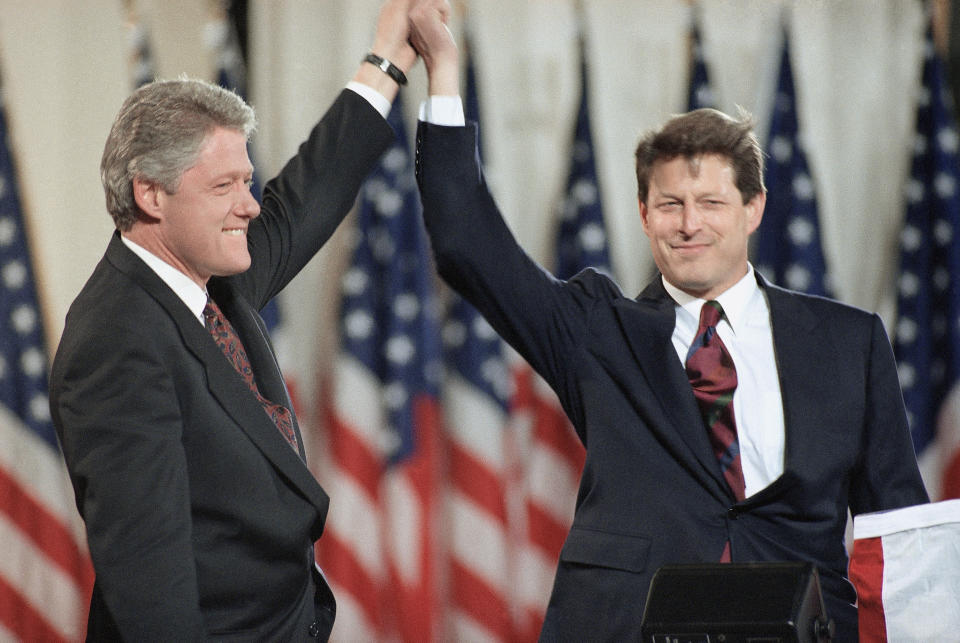 FILE - President-elect Bill Clinton stands with his running mate Al Gore on the stage at the Old State House Nov. 4, 1992 in Little Rock, Arkansas during the celebration of their victory over George Bush. A new CNN Films documentary explores the role of the U.S. vice presidency, which in modern times has emerged into a more powerful position. Still, the film notes that a veep's duties are all up to the president. (AP Photo/Susan Ragan, File)