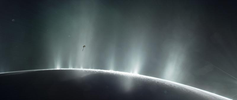 NASA's Cassini spacecraft is shown diving through the plume of Saturn's moon Enceladus, in 2015, in this photo illustration. NASA/JPL-Caltech/Handout via REUTERS ATTENTION EDITORS - THIS IMAGE WAS PROVIDED BY A THIRD PARTY. EDITORIAL USE ONLY.
