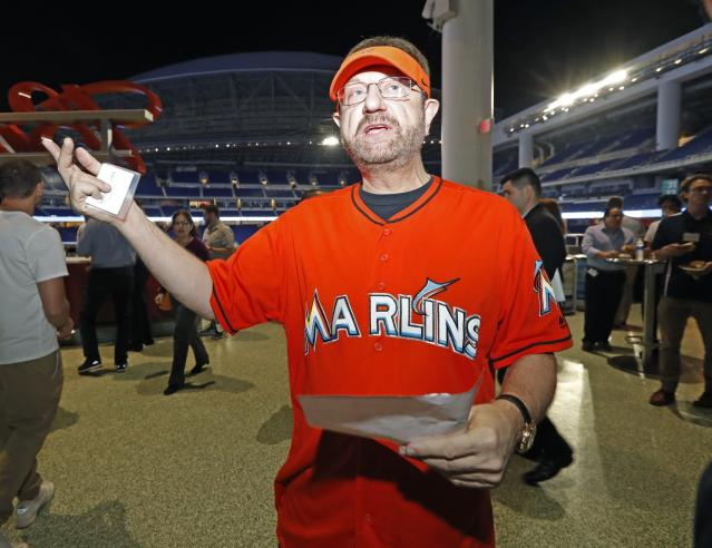 Marlins Man, who is feuding with the Marlins, is signing a one-day contract with the team. (AP)