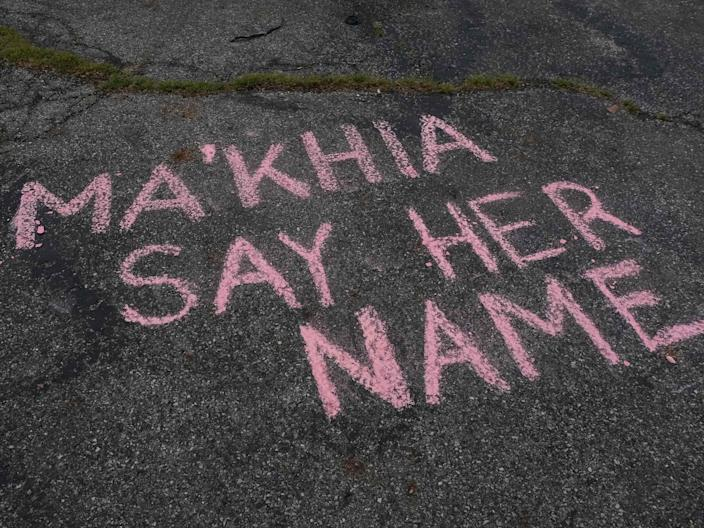 <p>Supporters write messages in chalk at a vigil in Columbus, Ohio on 21 April 2021 in memory of MaKhia Bryant, 16, who was shot and killed by a Columbus Police Department officer</p> ((AFP via Getty Images))