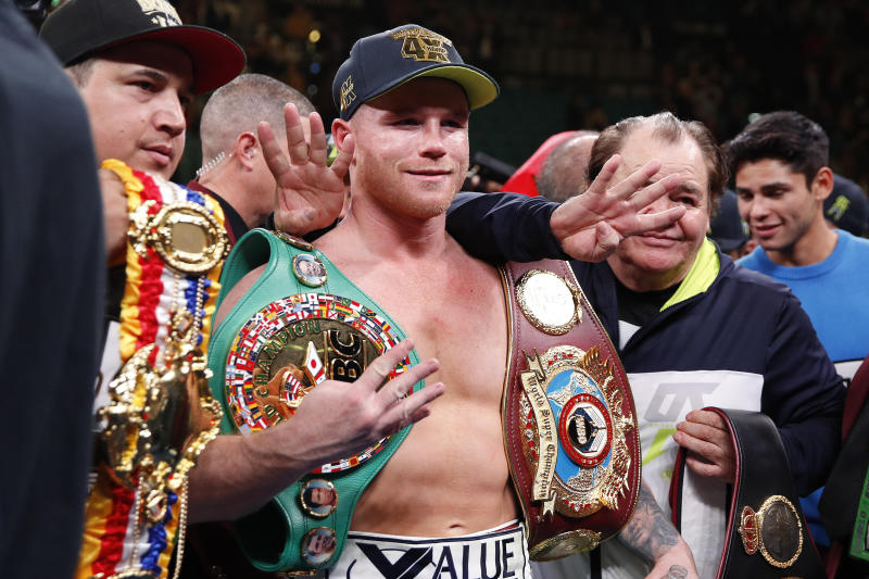 Canelo Alvarez poses for photos after defeating Sergey Kovalev by knockout.