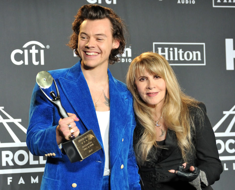 L-R: Harry Styles and Stevie Nicks in the press room at the 2019 Rock and Roll Hall of Fame Induction Ceremony at the Barclays Center in Brooklyn, NY on March 29, 2019. (Photo by Stephen Smith/SIPA USA)