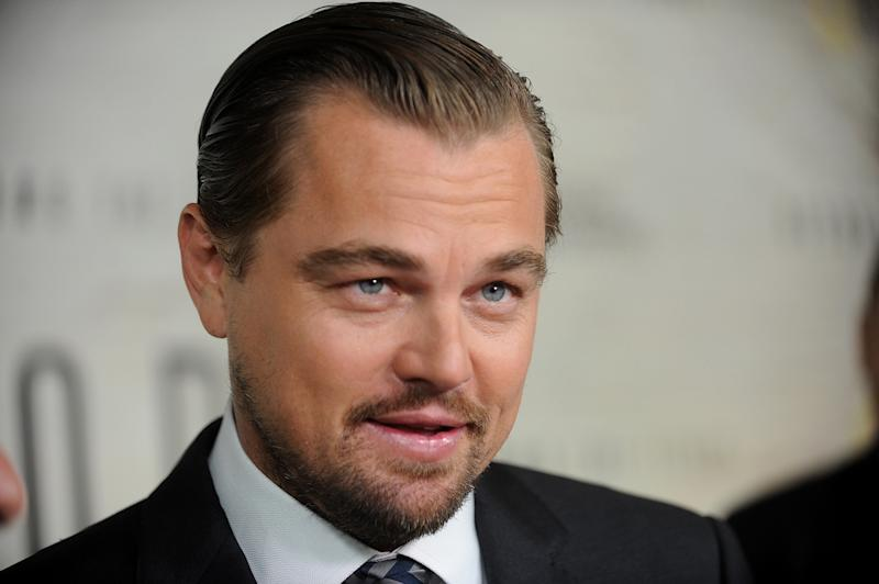 """FILE - In this Oct. 20, 2016, file photo, Leonardo DiCaprio attends the premiere of the National Geographic Channel's """"Before The Flood,"""" at the United Nations. Longtime friends DiCaprio and Q-Tip hung out at an intimate showcase for an Australian band making its New York City debut late Wednesday, March 29, 2017. The Oscar-winning actor and Grammy-winning rapper were in the small audience at Ludlow House as trio Chase Atlantic performed songs in a stripped, raw form. (Photo by Brad Barket/Invision/AP, File)"""