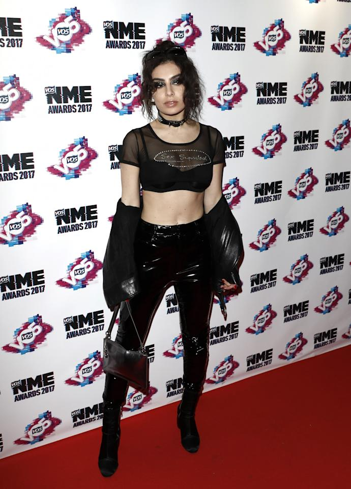 <p>PVC trousers and diamante – only for the brave, Charli [Photo: Getty/John Phillips] </p>