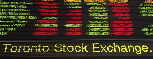 Toronto stocks close up slightly, loonie up; U.S. stock markets mixed