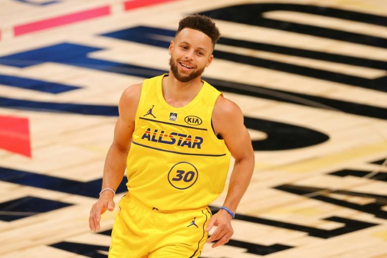 Golden State's Stephen Curry, seen here during the NBA All-Star Game, put up 32 points on his 33rd birthday to lead the Warriors to a 131-119 NBA victory over the Utah Jazz