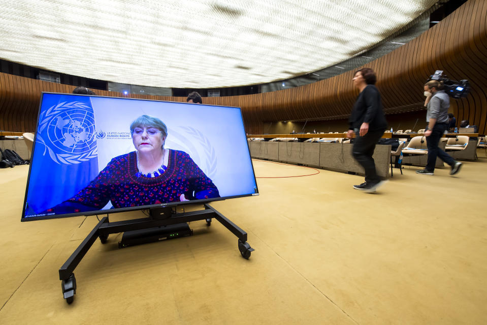CORRECTING DATE TO 27 - UN High Commissioner for Human Rights Michelle Bachelet, is displayed on a screen as she delivers her speech during a special session of the UN Human Rights Council to discuss situation in the Occupied Palestinian Territory, at the European headquarters of the United Nations in Geneva, Switzerland, Thursday, May 27, 2021. (Martial Trezzini/Keystone via AP)