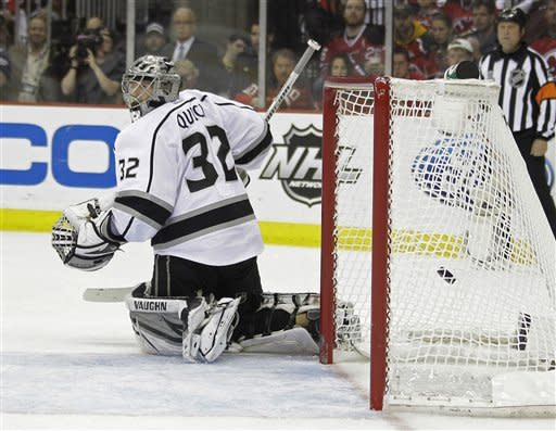 Los Angeles Kings' Jonathan Quick watches a goal by New Jersey Devils' Bryce Salvador score in the second period during Game 5 of the NHL hockey Stanley Cup finals, Saturday, June 9, 2012, in Newark, N.J.. (AP Photo/Julio Cortez)