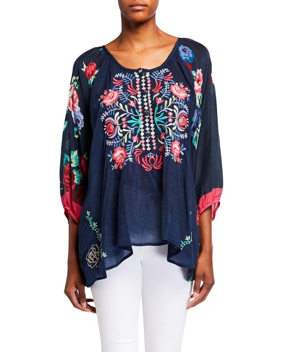 "<p><strong>Johnny Was</strong></p><p>neimanmarcus.com</p><p><strong>$105.00</strong></p><p><a href=""https://www.neimanmarcus.com/p/johnny-was-rosey-embroidered-floral-print-blouse-prod226770197"" rel=""nofollow noopener"" target=""_blank"" data-ylk=""slk:Shop Now"" class=""link rapid-noclick-resp"">Shop Now</a></p><p>This Johnny Was embroidered tunic is another exact match! Sorry ladies, Marlboro Man is not included. </p>"