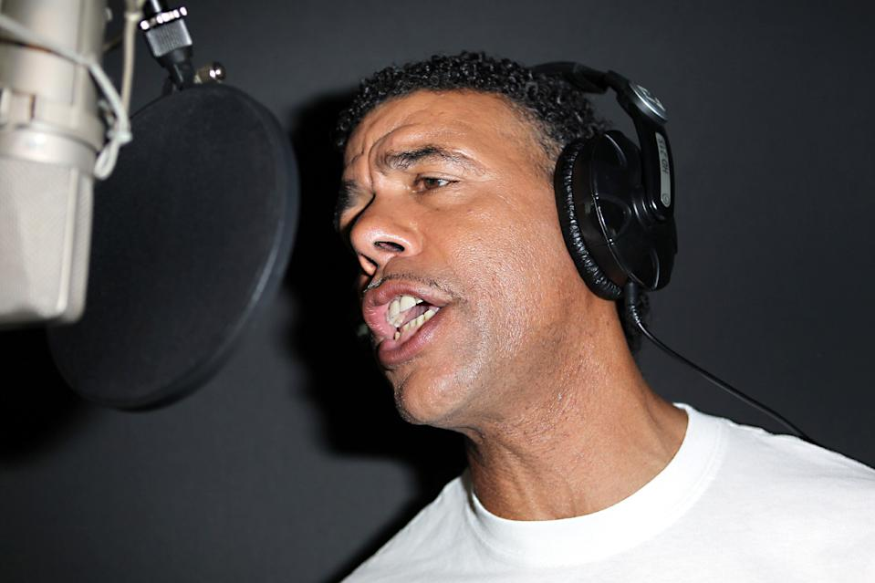 TV pundit Chris Kamara sings Sing 4 England, the official England song for Euro 2012, at a recording studio in central London. The song has the backing of the Football Association with all proceeds going to Marie Curie Cancer Care.   (Photo by Sean Dempsey/PA Images via Getty Images)