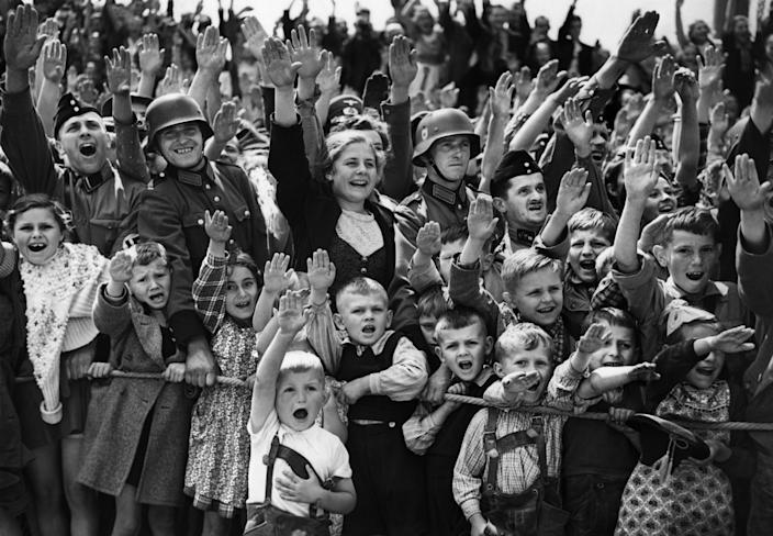 A crowd of German women, children and soldiers give the Nazi salute on June 19, 1940. (Photo: AP)