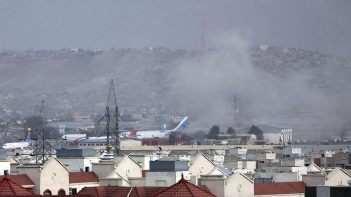 Smoke rises from explosion outside the airport in Kabul, Afghanistan, Thursday, Aug. 26, 2021. The explosion went off outside Kabul's airport, where thousands of people have flocked as they try to flee the Taliban takeover of Afghanistan. (Wali Sabawoon/AP)