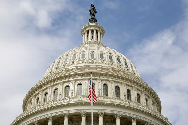 FILE PHOTO: The U.S. flag flies in front of the Capitol Dome at the U.S. Capitol in Washington