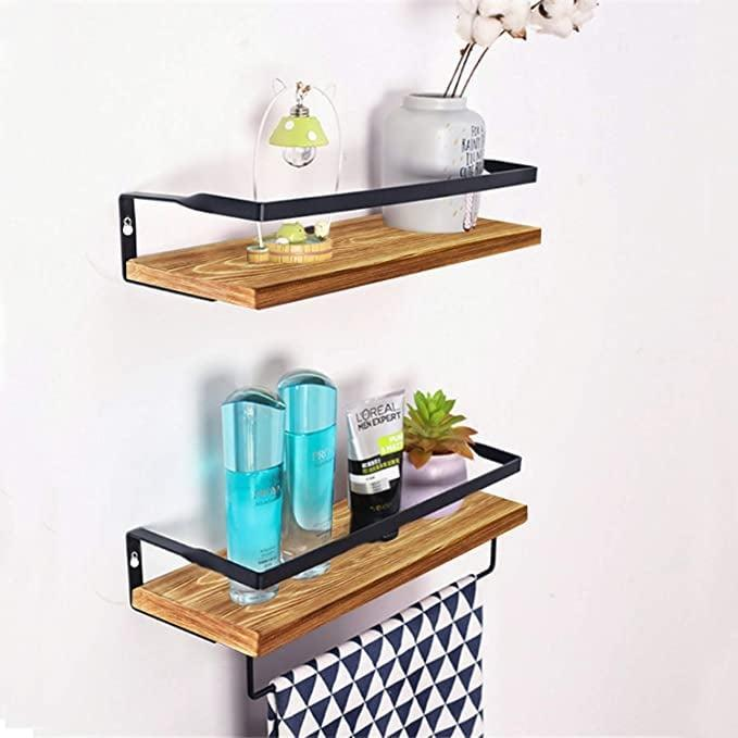 <p>Add extra storage with these chic <span>homyfort Floating Bathroom Shelves with Rails Set of 2</span> ($15, originally $24).</p>