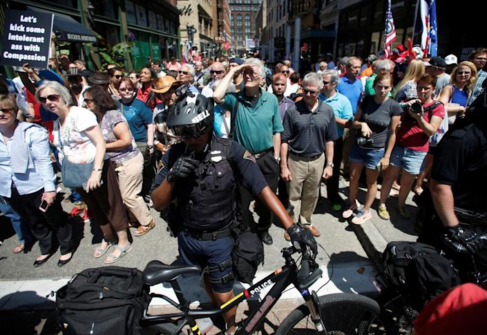 """<p>Law enforcement on bikes block a street as protesters (not pictured) hold a banner reading """"Wall Off Trump"""" near an entrance to the arena hosting the Republican National Convention in Cleveland on July 20, 2016. (Photo: Jim Urquhart/Reuters</p>"""