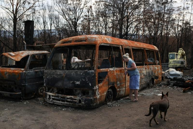 A resident returns to her property following the recent bushfires in Conjola Park