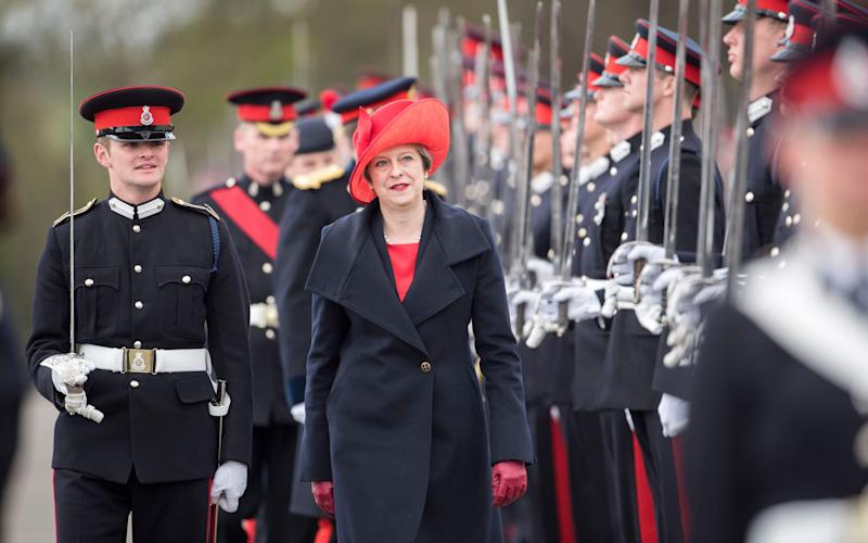 Prime Minister Theresa May represents Queen Elizabeth II as the reviewing officer - Credit: Paul Grover/The Daily Telegraph/Paul Grover/The Daily Telegraph