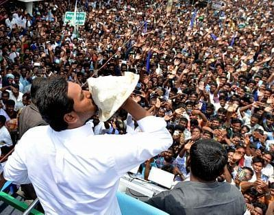 Amaravati: YSR Congress Party (YSRCP) Chief Jagan Mohan Reddy blows a conch as he celebrates with party workers after the YSRCP emerged victorious in the Andhra Pradesh Assembly elections in Amaravati, on 23 May 2019.