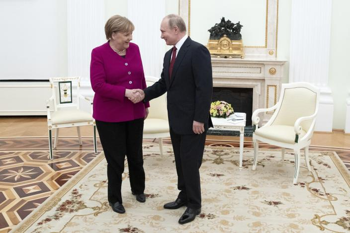 Russian President Vladimir Putin, right, and German Chancellor Angela Merkel Greer each other prior to the talks in the Kremlin in Moscow, Russia, Saturday, Jan. 11, 2020. Merkel visits Moscow to discuss current international issues such as the situation in Syria, Libya, Ukraine, US-Iran tensions, as well as bilateral relations. (AP Photo/Pavel Golovkin, Pool)