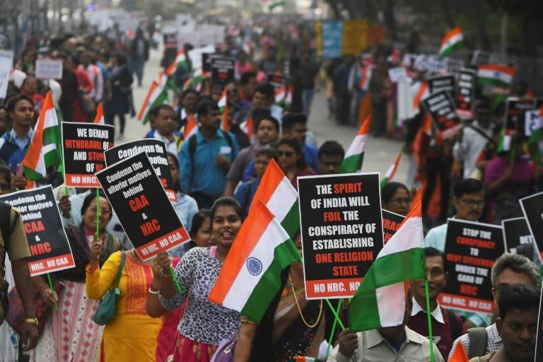 Thousands of Christians marched through Kolkata in protest against the new citizenship law (AFP Photo/Dibyangshu SARKAR)