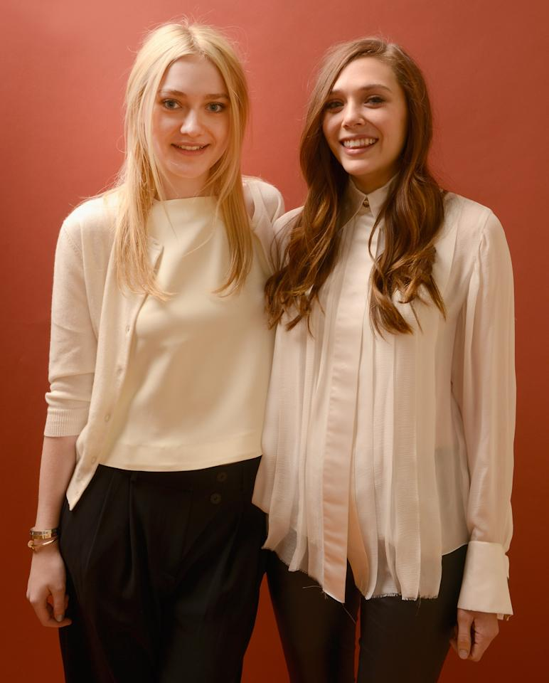 PARK CITY, UT - JANUARY 23:  Actresses Dakota Fanning (L) and Elizabeth Olsen pose for a portrait during the 2013 Sundance Film Festival at the Getty Images Portrait Studio at Village At The Lift on January 23, 2013 in Park City, Utah.  (Photo by Larry Busacca/Getty Images)