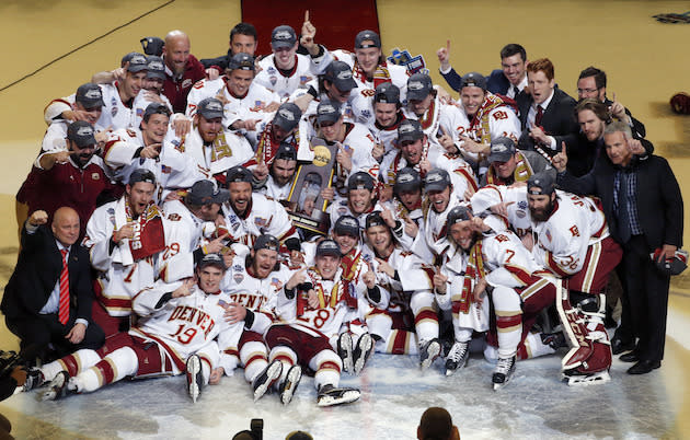 Denver players celebrate their 3-2 win over Minnesota-Duluth during an NCAA Frozen Four championship college hockey game, Saturday, April 8, 2017, in Chicago. (AP Photo/Nam Y. Huh)