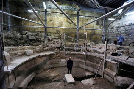 Israel Antiquities Authority archaeologist Dr. Joe Uziel stands inside a theatre-like structure during a media tour to reveal the structure which was discovered during excavation works underneath Wilson's Arch in the Western Wall tunnels in Jerusalem's Old City October 16, 2017. REUTERS/Ronen Zvulun