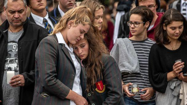 PHOTO: Schoolgirls comfort each other as they view flowers and tributes near Al Noor mosque, March 18, 2019, in Christchurch, New Zealand. (Carl Court/Getty Images, FILE)