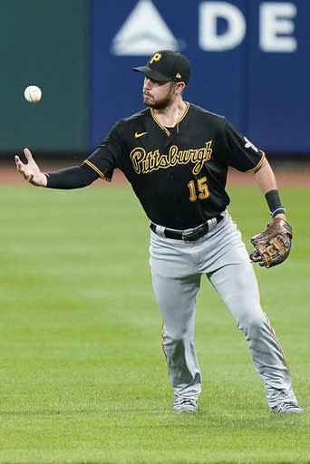 Pittsburgh Pirates shortstop JT Riddle fields the ball before throwing out Cincinnati Reds' Freddy Galvis at first base during the sixth inning of a baseball game in Cincinnati, Tuesday, Sept. 15, 2020. (AP Photo/Bryan Woolston)