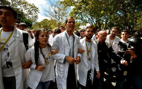 <span>Juan Guaido marches with fellow opponents of Nicolas Maduro in Caracas on Wednesday</span>