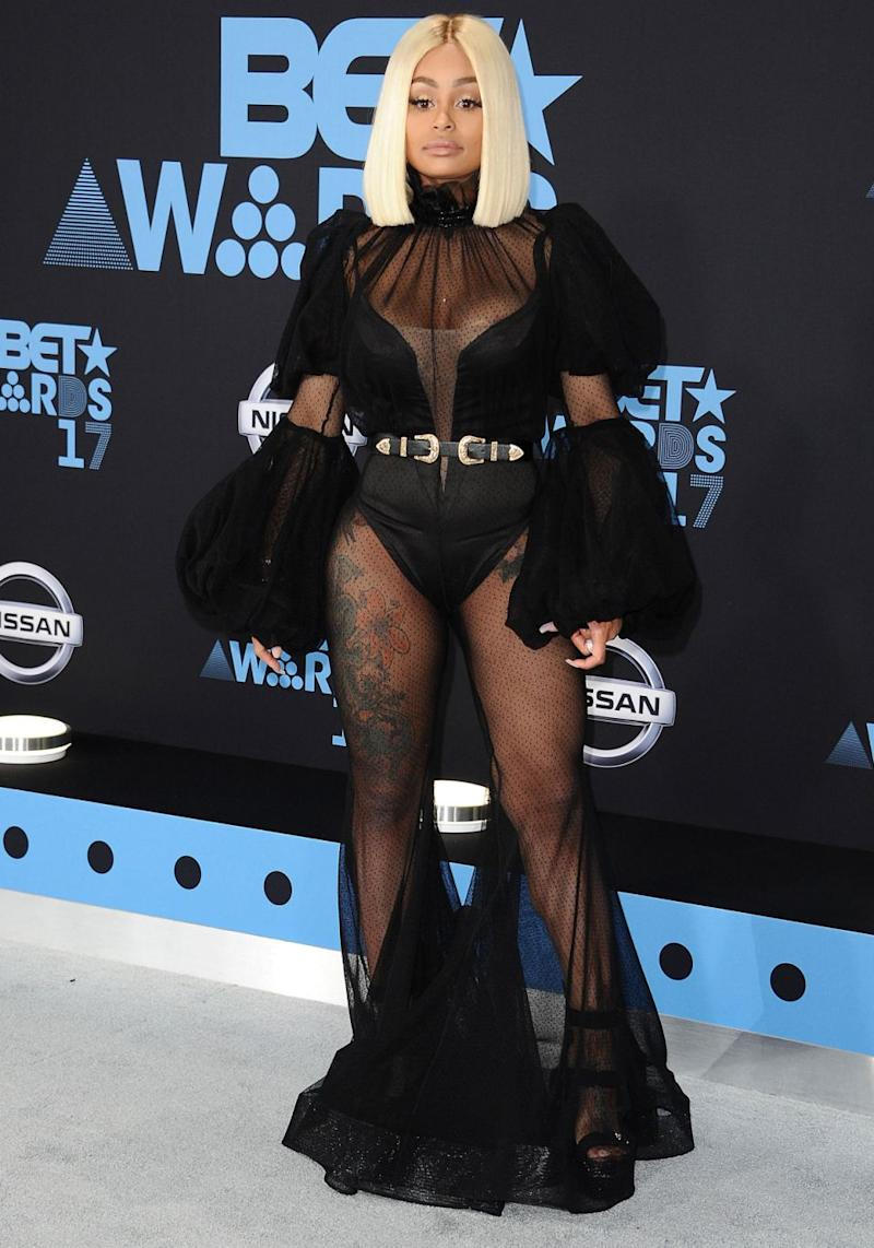 She didn't shy away from showing off her legs thanks to the black satin leotard underneath the dress' sheer panels. Source: Getty