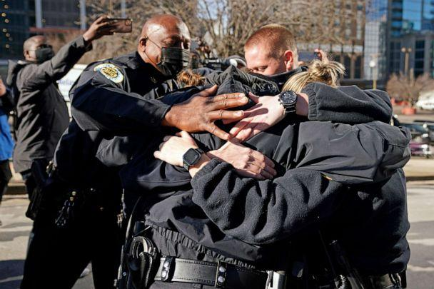 PHOTO: Nashville Police Chief John Drake, left, joins a group of police officers as they embrace after speaking at a news conference, Dec. 27, 2020, in Nashville, Tenn.  (Mark Humphrey/AP)