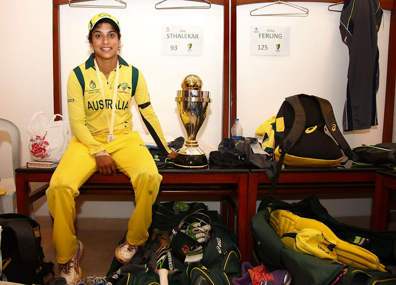 MUMBAI, INDIA - FEBRUARY 17:  Lisa Sthlaker of Australia, who retired after the game  with trophy in the rooms after the final between Australia and West Indies of the Women's World Cup India 2013 played at the Cricket Club of India ground on February 17, 2013 in Mumbai, India. (Photo by Graham Crouch/ICC via Getty Images)