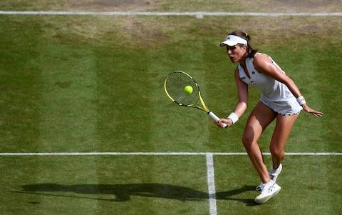 Johanna Konta of Great Britain plays a forehand in her Ladies' Singles Quarter Final match against Barbora Strycova of Czech Republic during Day Eight of The Championships  - Credit: GETTY IMAGES