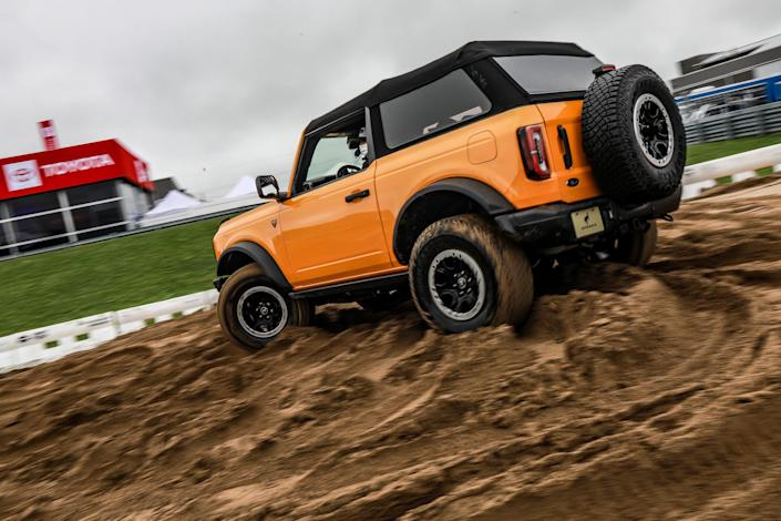 Attendees take a ride at the Ford Bronco Off Road Experience, during public days at Motor Bella, the all-new North American International Auto Show event at M1 Concourse in Pontiac on Sept. 23, 2021.