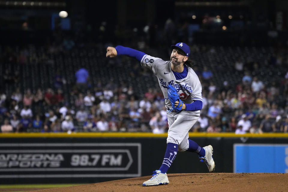 Los Angeles Dodgers pitcher Tony Gonsolin throws against the Arizona Diamondbacks in the first inning of a baseball game, Friday, Sept. 24, 2021, in Phoenix. (AP Photo/Rick Scuteri)
