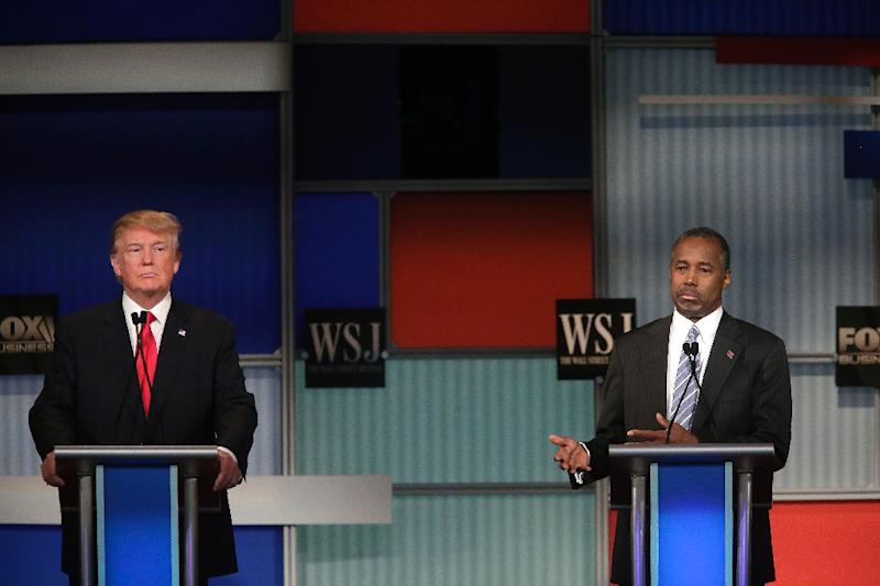 Republican presidential candidates Donald Trump (L) and Ben Carson (R) participate in the Republican Presidential Debate hosted by Fox Business and The Wall Street Journal November 10, 2015 in Milwaukee, Wisconsin (AFP Photo/Joshua Lott)