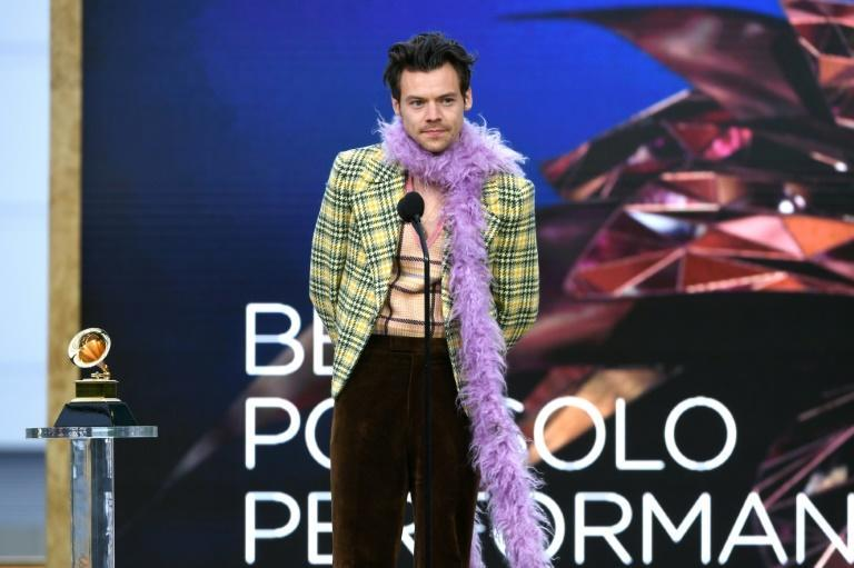 "British singer Harry Styles rocked a purple boa as he accepted the Grammy for Best Pop Solo Performance for ""Watermelon Sugar"""