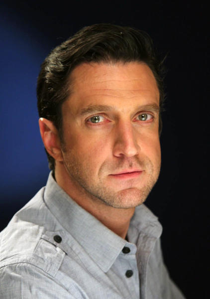 """In this April 19, 2012 photo, Raul Esparza, currently starring in the musical """"Leap of Faith"""" on Broadway, is shown in New York. He plays the huckster Jonas Nightingale, whose traveling revival show gets stranded in a drought-stricken Kansas town after their bus breaks down. (AP Photo/John Carucci)"""