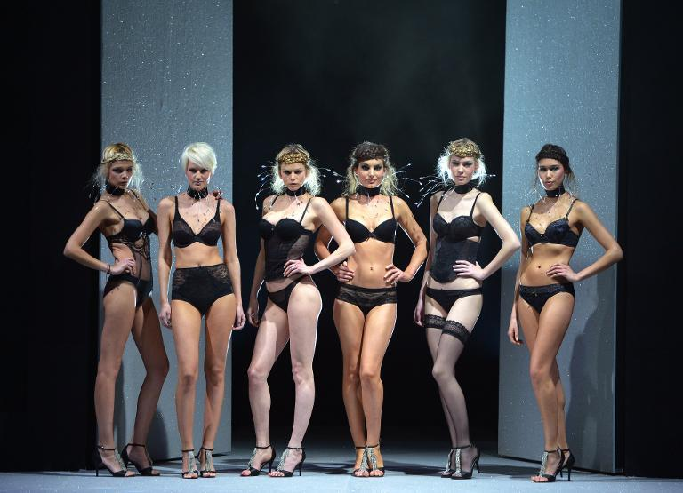 Models present underwear garments during the Salon de la lingerie (International Lingerie Fair) on January 20, 2013 in Paris