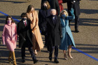 President Joe Biden and his wife Jill Biden walk in a parade during the Presidential Escort, part of Inauguration Day ceremonies, Wednesday, Jan. 20, 2021, in Washington. (AP Photo/David J. Phillip)