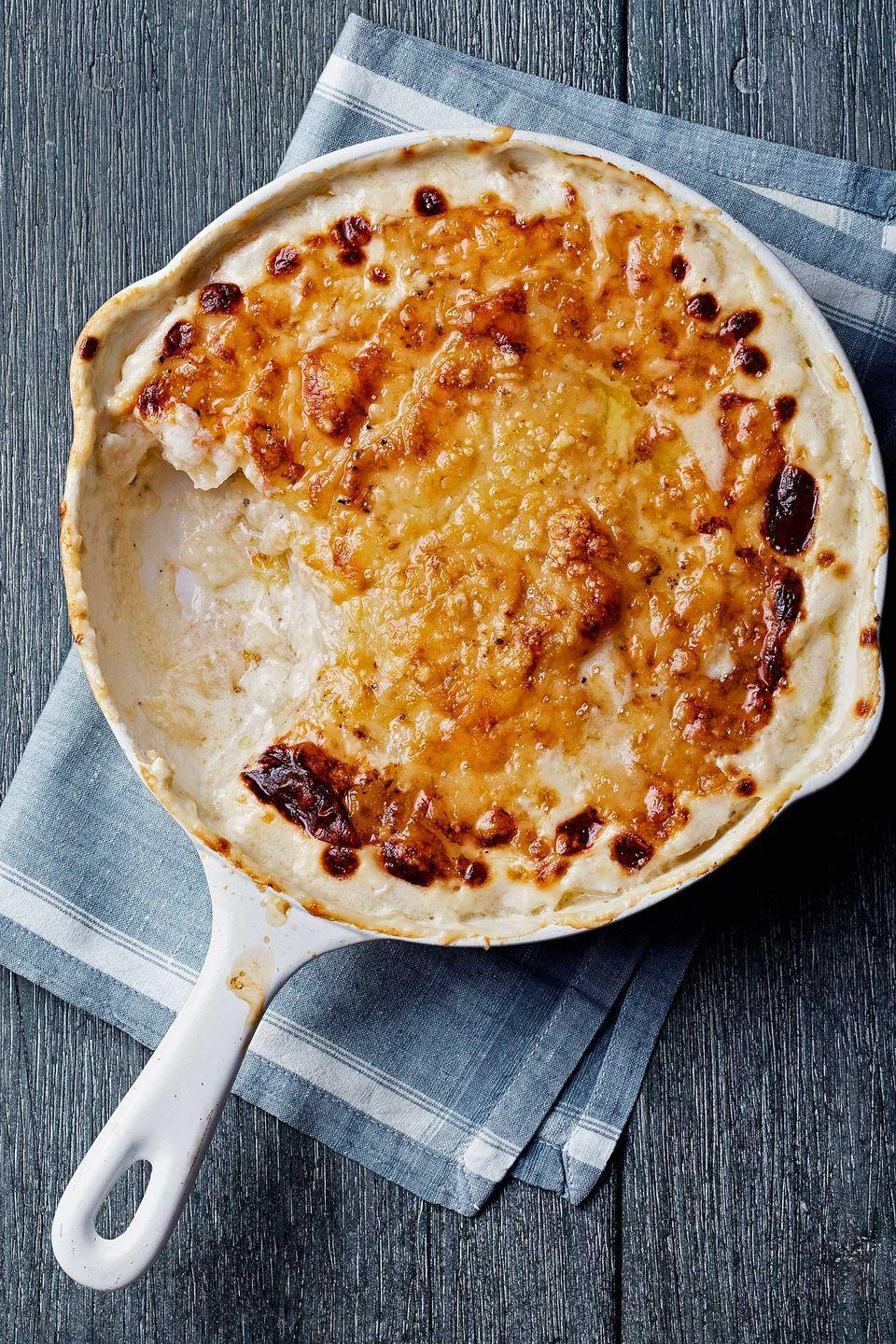"<p>This crowd-pleasing casserole combines little more than russet potatoes, Gruyère, and cream. Rubbing garlic on the pan before cooking contributes mellow depth to a rich classic.</p><p><strong><a href=""https://www.countryliving.com/food-drinks/recipes/a4567/potato-gratin-recipe-clx1113/"" rel=""nofollow noopener"" target=""_blank"" data-ylk=""slk:Get the recipe"" class=""link rapid-noclick-resp"">Get the recipe</a>.</strong></p>"