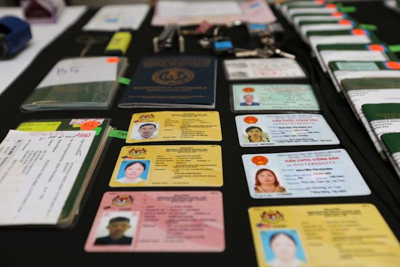 Vietnamese passports and other travel documents are pictured during a media conference in Putrajaya July 19, 2019. — Picture by Choo Choy May