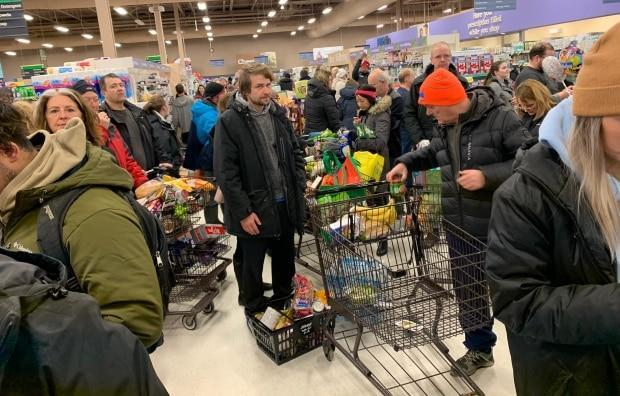 Low on food, blizzard-weary St. John's shoppers head straight to supermarkets