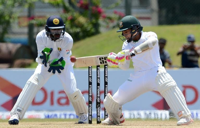 Bangladesh captain Mushfiqur Rahim plays a shot as Sri Lanka wicketkeeper Niroshan Dickwella looks during the first Test in Galle on March 9, 2017