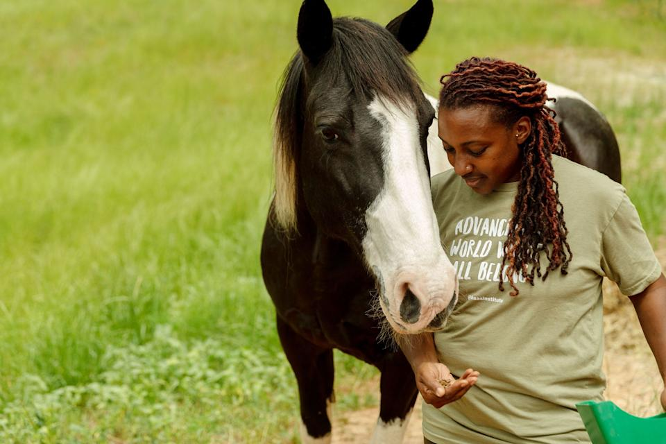 Keisha feeds her horse, Hercules, who helped inspire her to create the farm. (Photo: Lynsey Weatherspoon for HuffPost)