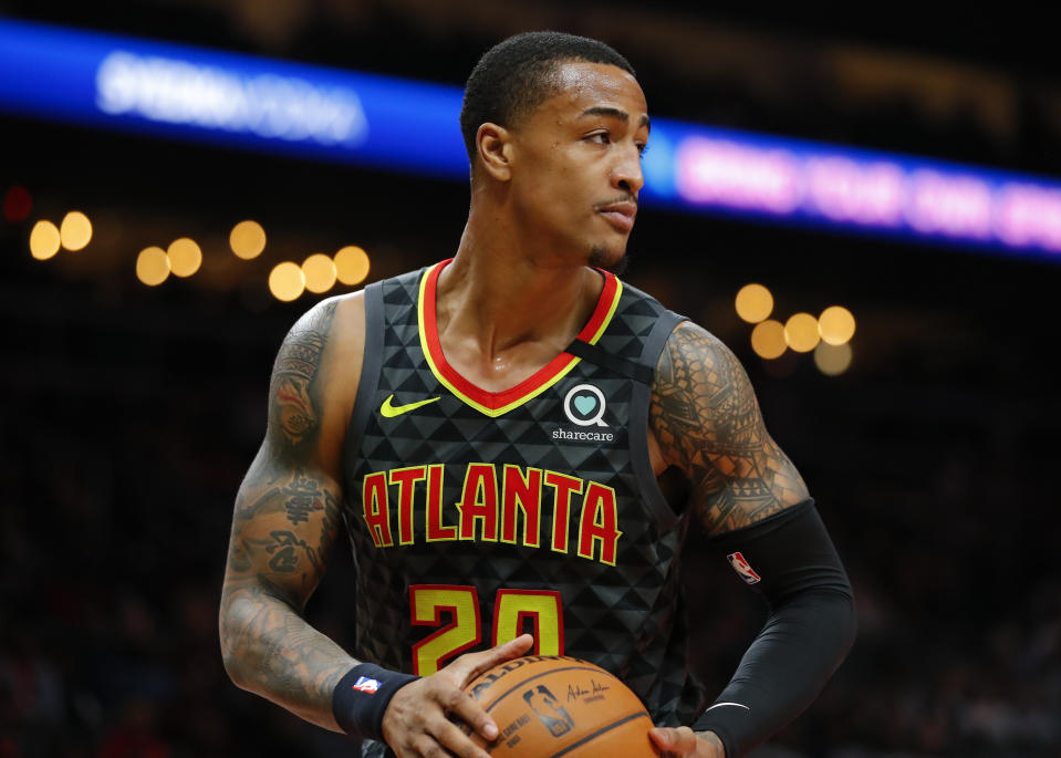 ATLANTA, GA - FEBRUARY 29: John Collins #20 of the Atlanta Hawks rebounds during the first half of an NBA game against the Portland Trail Blazers at State Farm Arena on February 29, 2020 in Atlanta, Georgia. NOTE TO USER: User expressly acknowledges and agrees that, by downloading and/or using this photograph, user is consenting to the terms and conditions of the Getty Images License Agreement. (Photo by Todd Kirkland/Getty Images)